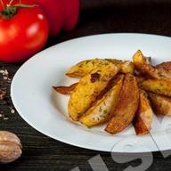 Картофель по-домашнему (с чесноком) Фото