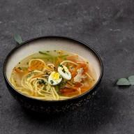 Суп с курицей и домашней лапшой Фото
