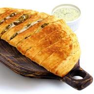 Хлебные ломтики с халапеньо и беконом Фото