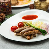 Колбаски из мраморной говядины гриль Фото