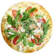 Пицца с лососем и рукколой Фото