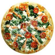 Пицца с лососем и шпинатом Фото