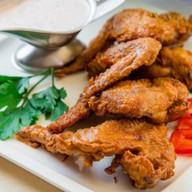 Куриные крылышки в соусе барбекю Фото