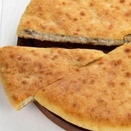 Осетинский пирог с курицей и картофелем Фото