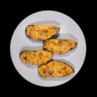 Мидии с сырным соусом Фото