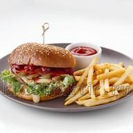 Бургер с мясной котлетой, апельсином Фото