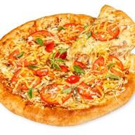 Пицца с цыпленком Фото