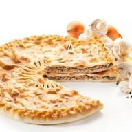 Пирог с грибами и луком Козоджын Фото