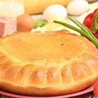 Пирог пицца с ветчиной Фото