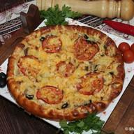 Сливочная фирменная пицца Фото
