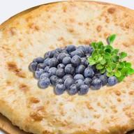 Осетинский творожный пирог с черникой Фото