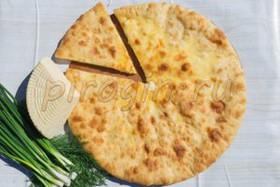 Осетинский пирог с сыром и зеленым луком - Фото