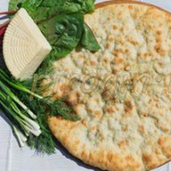 Осетинский пирог сыр, свекольные листья Фото