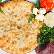 Осетинский пирог с говядиной и сыром Фото