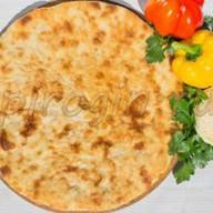Осетинский пирог капуста, грецкий орех Фото