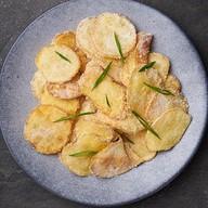 Слайсы - чипсы во вкусе сырный снег Фото