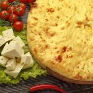 Осетинский пирог с козьим сыром уалибах Фото