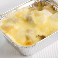 Курица с картофелем в сливочном соусе Фото
