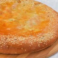 Пирог осетинский с курицей,сыром,грибами Фото