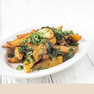 Картофельные дольки с чесноком Фото