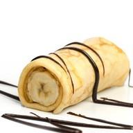 Блин с бананом и шоколадным топпингом Фото