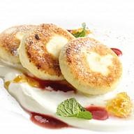 Сырники со сметаной Фото