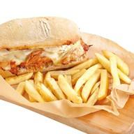 Сэндвич Casa Guedes со свининой и сыром Фото