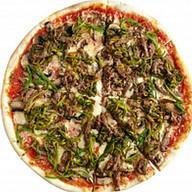 Пицца с говядиной и луком-пореем Фото