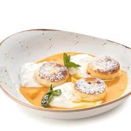 Сырники с апельсиновым соусом Фото