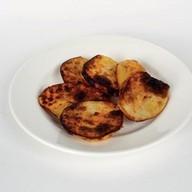 Картофель на огне Фото