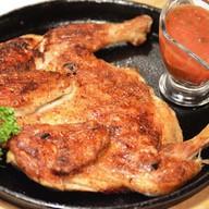 Цыпленок табака на мангале Фото