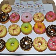Набор донатcов в глазури 9 пончиков Фото