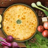 Осетинский пирог с листьями и сыром Фото
