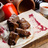 Говяжья печень на мангале Фото