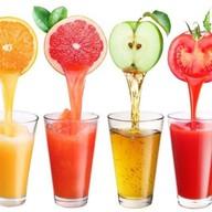 Сок свежевыжатый фруктовый Фото