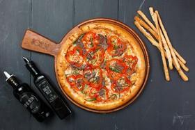 Пицца с говядиной и овощами - Фото