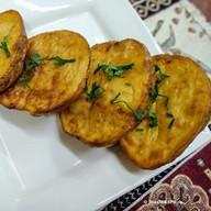Картофель в тандыре Фото