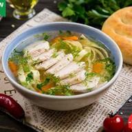 Суп куриный с лапшой и курицей-гриль Фото