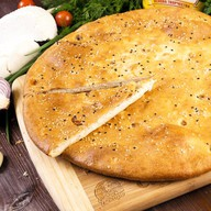 Осетинский пирог с курицей и сыром Фото