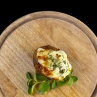 Печеный картофель с сыром и сметаной Фото