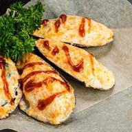 Гигантские мидии под сырным соусом Фото