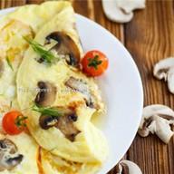 Омлет с сыром, грибами и томатами черри Фото