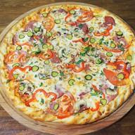 Фирменная пицца Челентано Фото