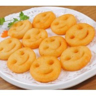 Картофельные смайлики фри Фото