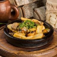 Картофель с грибами на кеци Фото