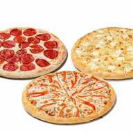 Три пиццы Фото
