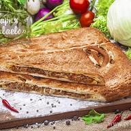 Пирог слоеный с капустой Фото