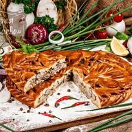Пирог с сомом Фото