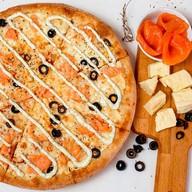 Лососевая пицца Фото