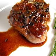 Мясо в красном соусе Фото